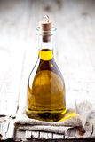 Fresh olive oil in bottle Stock Images