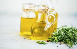 Fresh olive oil bottles with spices and herbs, organic healthy olive oil. Fresh olive oil bottles with spices and herbs, organic healthy fats olive oils stock photos