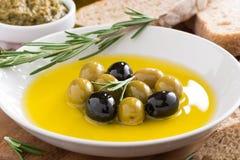 Fresh olive oil and Italian snacks, close-up Stock Photo