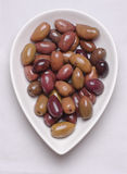 Fresh olives. Browny fresh olives in a white bowl Royalty Free Stock Image
