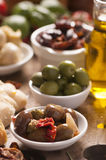 Fresh olives and olive oil on rustic wooden Stock Photo