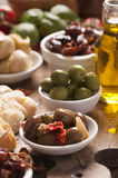Fresh olives and olive oil on rustic wooden Royalty Free Stock Images