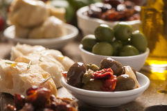 Fresh olives and olive oil on rustic wooden Royalty Free Stock Photography