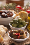 Fresh olives and olive oil on rustic wooden Stock Image