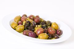 Fresh olives and prunes sauce in a white bowl. Stock Photos