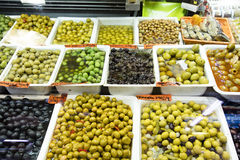 Fresh olives in a Spanish market. Fresh olives for sale in a Spanish market some pitted some stuffed with almond garlic cheese or pimento royalty free stock images