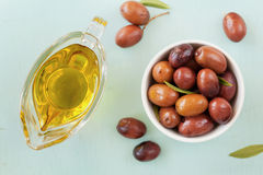 Fresh olives in white bowl on wooden table Royalty Free Stock Image