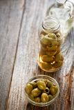Fresh olives on a wooden table Royalty Free Stock Photography