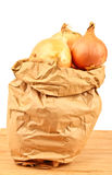 Fresh onion in a brown paperbag Stock Photo