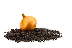 Fresh onion with dried black peppercorn Stock Images