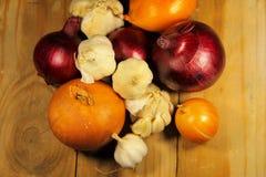 Fresh onion and garlic on wooden table. Fresh onion and garlic on the wooden table Stock Image