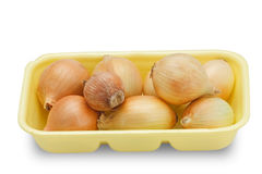 Fresh onions (with clipping path). Onion´s tray like you can usually find in a supermarket. Isolated on white background Royalty Free Stock Images