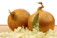 Fresh onions with cut pieces coming out Stock Images