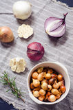 Fresh onions and garlic. On a table Royalty Free Stock Photography