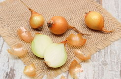 Fresh onions on jute canvas, healthy nutrition and strengthening immunity Royalty Free Stock Photos