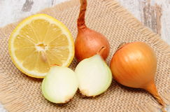 Fresh onions and lemon, healthy nutrition and strengthening immunity Royalty Free Stock Photo