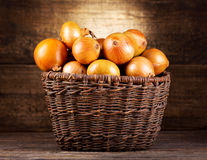 Fresh onions in wicker basket Stock Photos