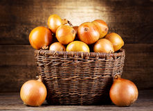 Fresh onions in wicker basket Royalty Free Stock Image