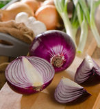 Fresh onions on  a wooden cutting board Stock Photo