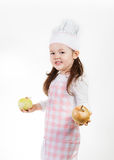 Fresh Onions. A young girl uses fresh onions to make something good to eat Royalty Free Stock Photo