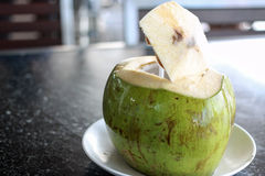 Fresh opened coconut drink Royalty Free Stock Photo