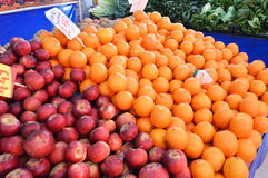 Fresh orange and apple picture in a grocery store royalty free stock photo
