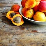 Fresh orange apricots. Natural fresh orange apricots on the plate Stock Photos