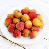 Fresh orange apricots. On white painted wooden background Royalty Free Stock Image