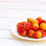 Fresh orange apricots. On white wooden background. Healthy summer food Royalty Free Stock Photo
