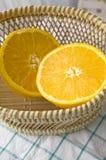 Fresh orange in basket. Close up fresh half orange put in basket Royalty Free Stock Images