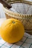Fresh orange with basket Royalty Free Stock Image