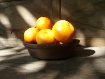 Fresh lucky orange basket on wooden table Royalty Free Stock Image