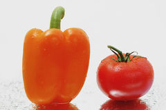 Fresh Orange bell pepper & ripe  tomato. Isolated healthy eating image Royalty Free Stock Photo