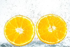 Fresh orange with bubbles Stock Photos