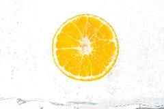 Fresh orange with bubbles Stock Photo