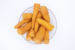 Fresh orange carrot in glass bowl top view photo. Many carrots cleaned for cooking. Healthy diet ingredient. Summer vegetable. Organic garden harvest. Carrot Royalty Free Stock Images