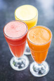 Fresh orange carrot and watermelon fruit juice Stock Image