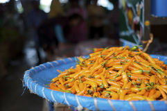 Fresh orange chili pepper at a street market Stock Images