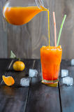 Fresh orange cocktail drink with ice cubes Stock Images