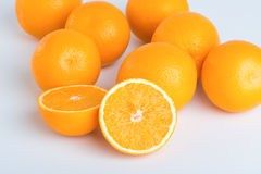 Fresh orange and cut in half Royalty Free Stock Photography