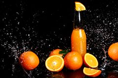 Fresh orange drink with splashes of water Stock Image