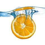 Fresh orange dropped into water Stock Image