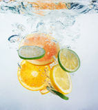 Fresh orange dropped into water Royalty Free Stock Photos