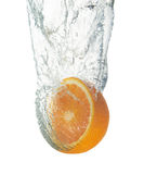 Fresh orange dropped into water Stock Photography