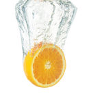 Fresh orange dropped into water Stock Images