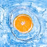 Fresh orange dropped into water with bubbles Stock Photography