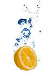Fresh orange dropped into water with bubbles Stock Photos