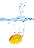 Fresh orange dropped into water with splash Stock Photo
