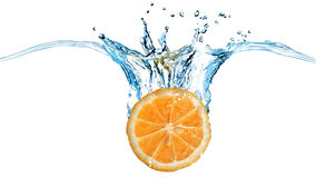 Fresh orange dropped into water with splash Stock Images