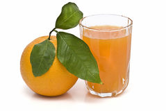 A fresh orange and a fresh juice. stock photos